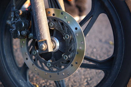 used: This is close up of motobike front wheel. Stock Photo