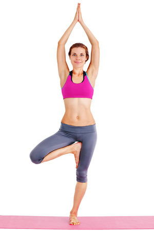 Portrait of young beautiful woman doing yoga - isolated on white. photo