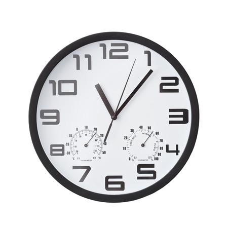 analog clock: Big black round clock on white wall.