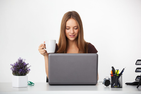 Portrait of young beautifull business woman working at her office.