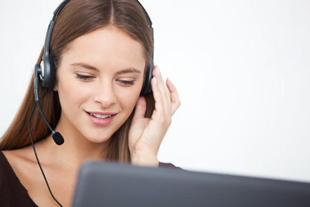 Portrait of happy cheerful beautiful young support phone operator with headset.