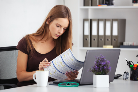 business woman working: Portrait of young beautiful business woman working at her office. Stock Photo