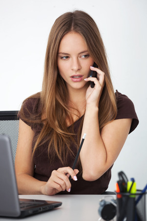 Office women: Portrait of young beautifull business woman working at her office.