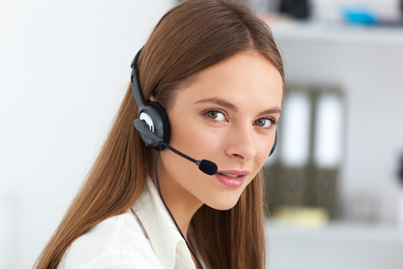 call girl: Portrait of happy cheerful beautiful young support phone operator with headset.