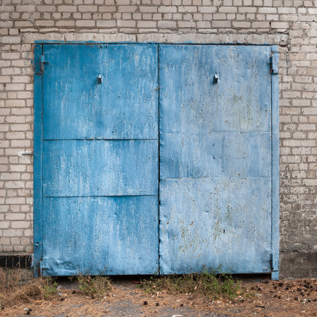 corrosion: This is old weathered painted garage doors.