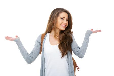 若い幸せな学生の疑問 - 白で隔離に肩をすくめします。 写真素材