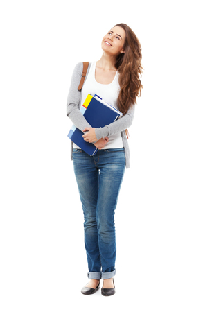 Young happy female student looking looking up isolated on white.