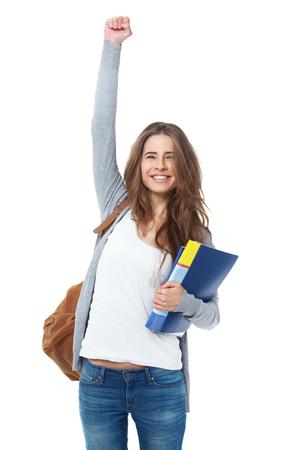 흰색 배경에 고립 된 그녀의 손을 제기하는 여자 학생을 흥분. 스톡 콘텐츠