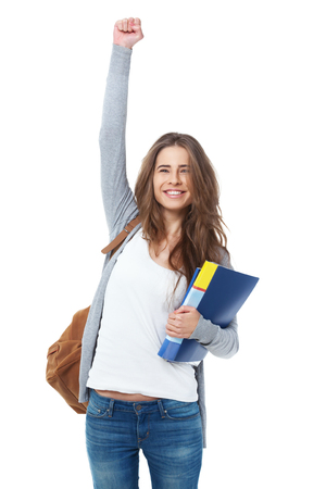 raising: Excited female student raising hand her hand isolated on white background.