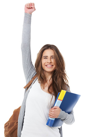 Excited female student raising hand her hand isolated on white background.