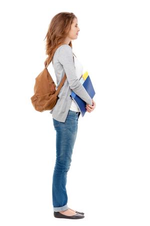 full body: Profile of happy female student isolated on white background. Stock Photo