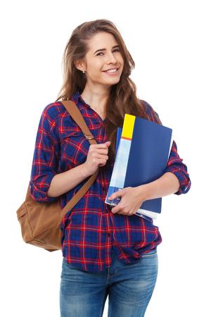 Jonge gelukkige die student met boeken op witte achtergrond wordt geïsoleerd. Stockfoto
