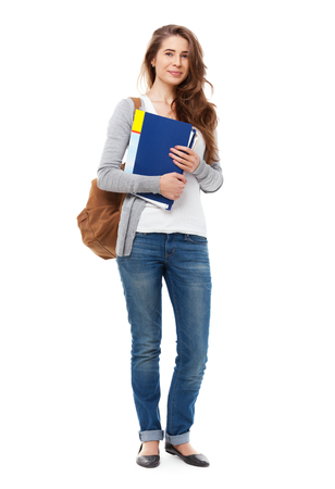 Young happy student isolated on white background.