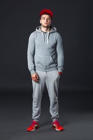 fullbody: Fullbody portrait of young cool man standing  on dark gray background. Stock Photo