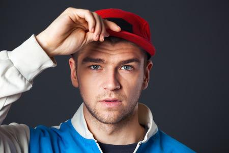 cool guy: Studio portrait of cool looking young guy posing in studio. Stock Photo
