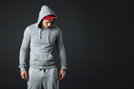 cool guy: Studio portrait of cool looking young guy in sportswear.
