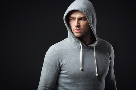 Studio portrait of cool looking young guy in sportswear. 免版税图像 - 51461606