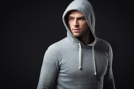 bad feeling: Studio portrait of cool looking young guy in sportswear.
