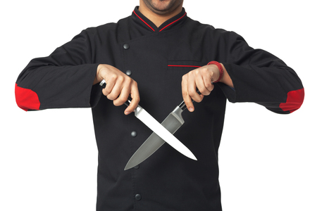 knifes: Afro American professional cook holding knifes- isolated on white background.