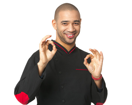 ideally: Portrait of happy Afro American professional cook isolated on white.