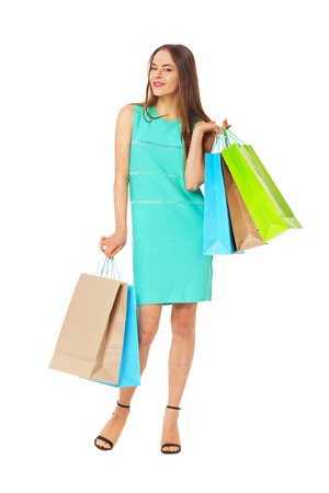 isolated woman: Fullbody portrait of beautiful happy woman with bags isolated on white. Shopping concept.
