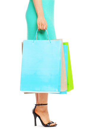 midsection: Midsection of beautiful woman with shopping bags isolated on white background. Shopping concept.