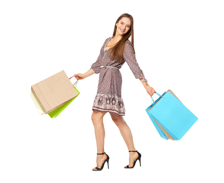 fullbody: Fullbody portrait of beautiful happy woman with bags isolated on white. Shopping concept.