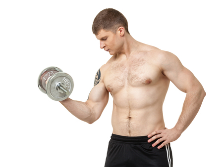 powerfully: Muscular young man exercising with dumbbell on white background