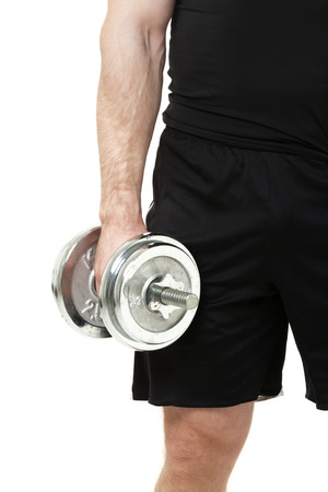 powerfully: Muscular young man with dumbbell on white background