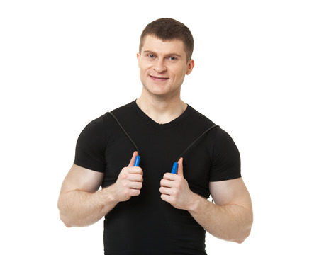 young guy: Positive fit young man with jumping rope isolated on white background.