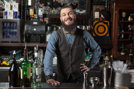 welcome party: Barman at work on his workplace.
