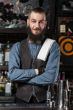 barman: Happy barman at work with crossed hands.