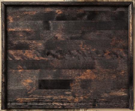 trompo de madera: Cierre de la bandeja de madera oscura. Vista superior. Foto de archivo