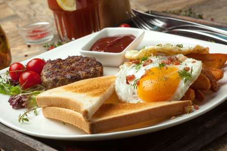 sunny side up: Minced beef on the grill, fried eggs sunny side up with bacon crumbs, crisp Irish , toast , wheat or rye.