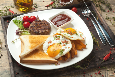 side of beef: Minced beef on the grill, fried eggs sunny side up with bacon crumbs, crisp Irish , toast , wheat or rye.