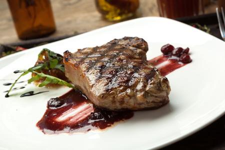 juicy: Fat, juicy steak beef thick edge, grain-fed , wet binning. Served with red wine sauce.