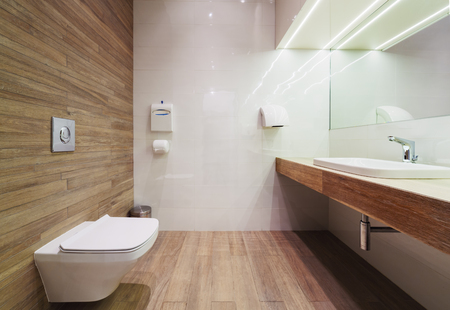 a restroom: Modern public empty restroom with washstand mirror. Stock Photo