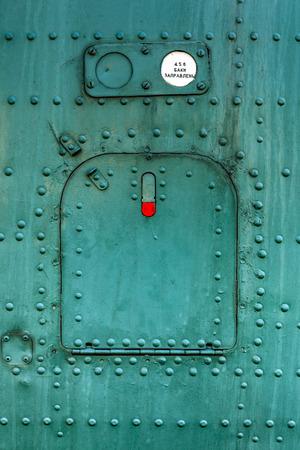 aircraft rivets: Old green painted aircraft hatch close up.