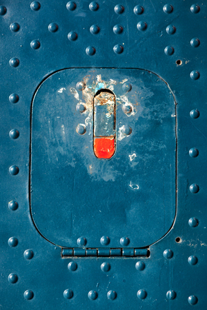 aluminum airplane: Old blue painted aircraft hatch close up. Stock Photo