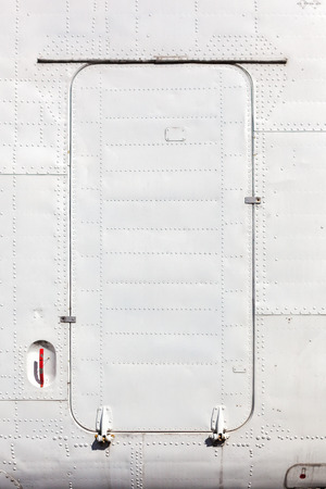 fuselage: Old white painted aircraft fuselage close up. Stock Photo