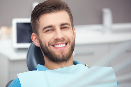 My smile is perfect! Portrait of happy patient in dental chair. Stok Fotoğraf