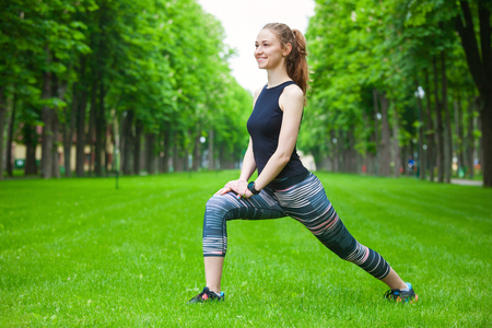 woman stretching: Full length shot of an attractive young woman stretching before running.