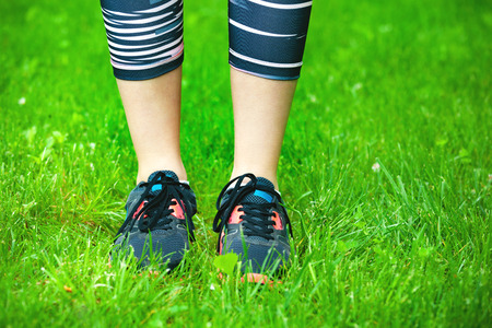 Closeup of running shoes on grass - concept image. Stock Photo