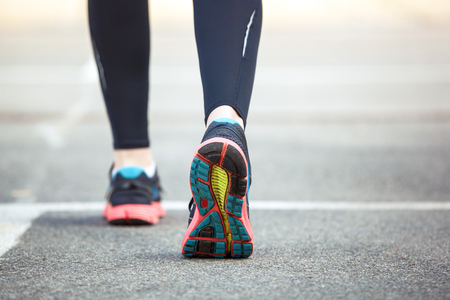 Close up of running shoes on road. Rear view.