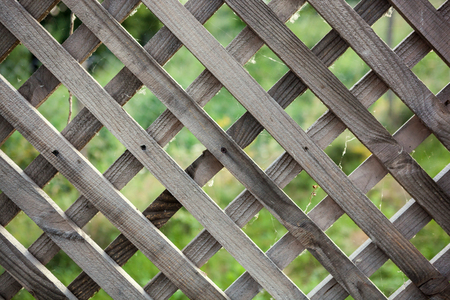 rhomb: Close up of an old rough rhomb shaped fence.