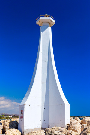 This is small lighthouse in Zygi Marina. Cyprus. Stock Photo