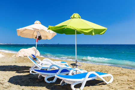 Summer beach with sun beds and umbrellas. Cyprus.