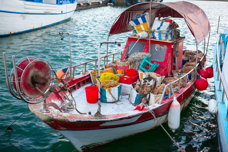 limassol: Fishing boat with fishing gear in Limassol Old Port, Cyprus. Stock Photo