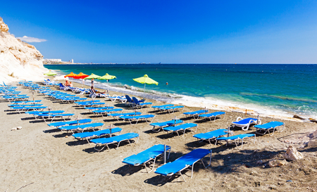 CYPRUS, PENTAKOMO- SEPTEMBER 22 2016: rows of blue sunbeds on Kalymnos Beach.