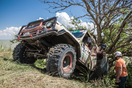 KIRILLOVKA, UKRAINE - MAY 25, 2016: Zaporizhia Trophy 2016. II stage of offroad trophy Ukrainian championship. Participant taking photo near record point. Editorial